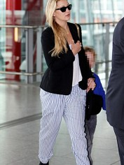 Kate Hudson may be wearing PJ pants in the aiport but sunnies help.