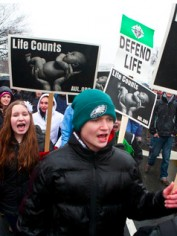 Anti-abortion protestors with signs we're prepared to republish