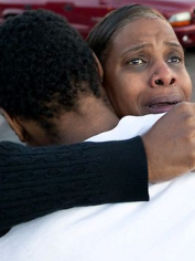 Shamecca Davis hugs her son Isaiah Bow, who survived the Colorado shooting.