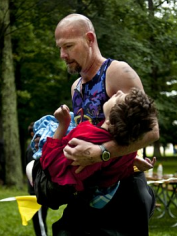 Rick carries Maddy during the running leg of the triathlon.
