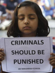 A little girl protests, following the gang rape and death of a woman in New Delhi.