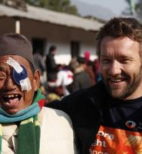 Joel with a patient after surgery in Nepal.